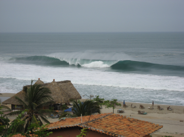 Plunging surf break at Puerto Escondido, Mexico. This swell may have been created in the Southwest Pacific Ocean. Photo by Ole Johann Aarnes.