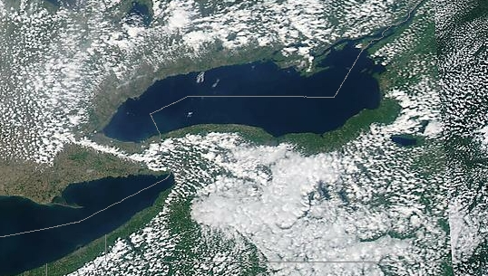 Lake breeze around Lake Erie and Lake Ontario, 24 May 2012 from NASA's AQUA satellite. Note the convergence cloud line between the two lakes. Source: http://blogs.agu.org/wildwildscience/2012/05/24/lake-breeze-around-lake-erie-and-lake-ontario/.